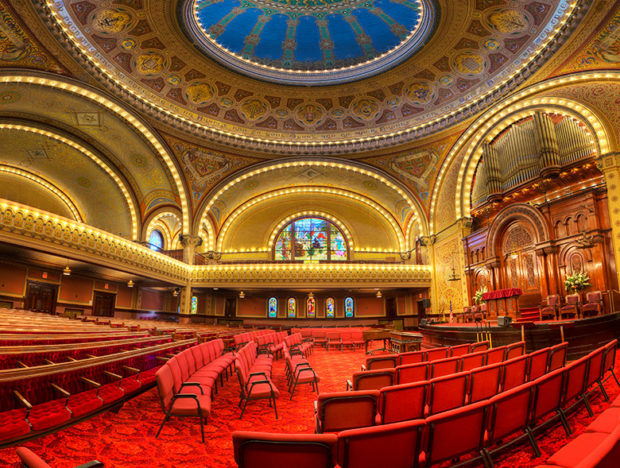 The carpet, seating area, and painted dome inside Congregation Sherith Israel's sanctuary building